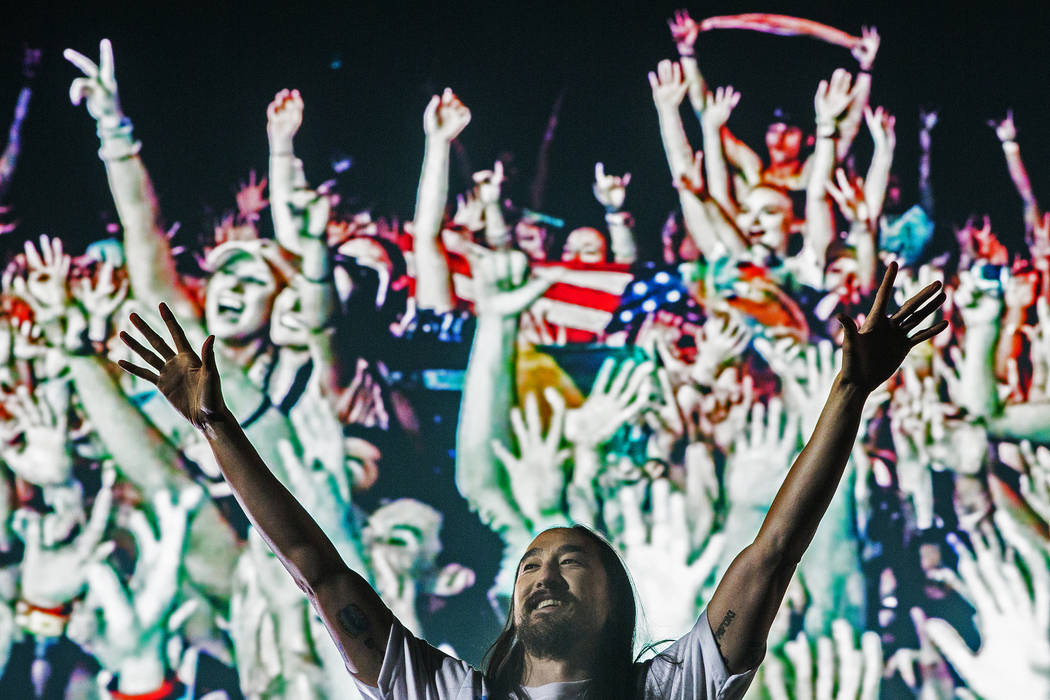 Steve Aoki pumps up the crowd during his performs at the Circuit Grounds stage on day three of ...