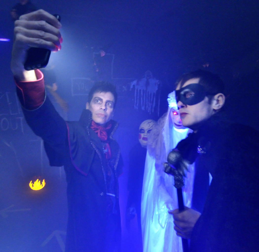 Rick DiCarlo, left, and Jeff Damon take a selfie in the haunted house at a Red Rock Country Clu ...