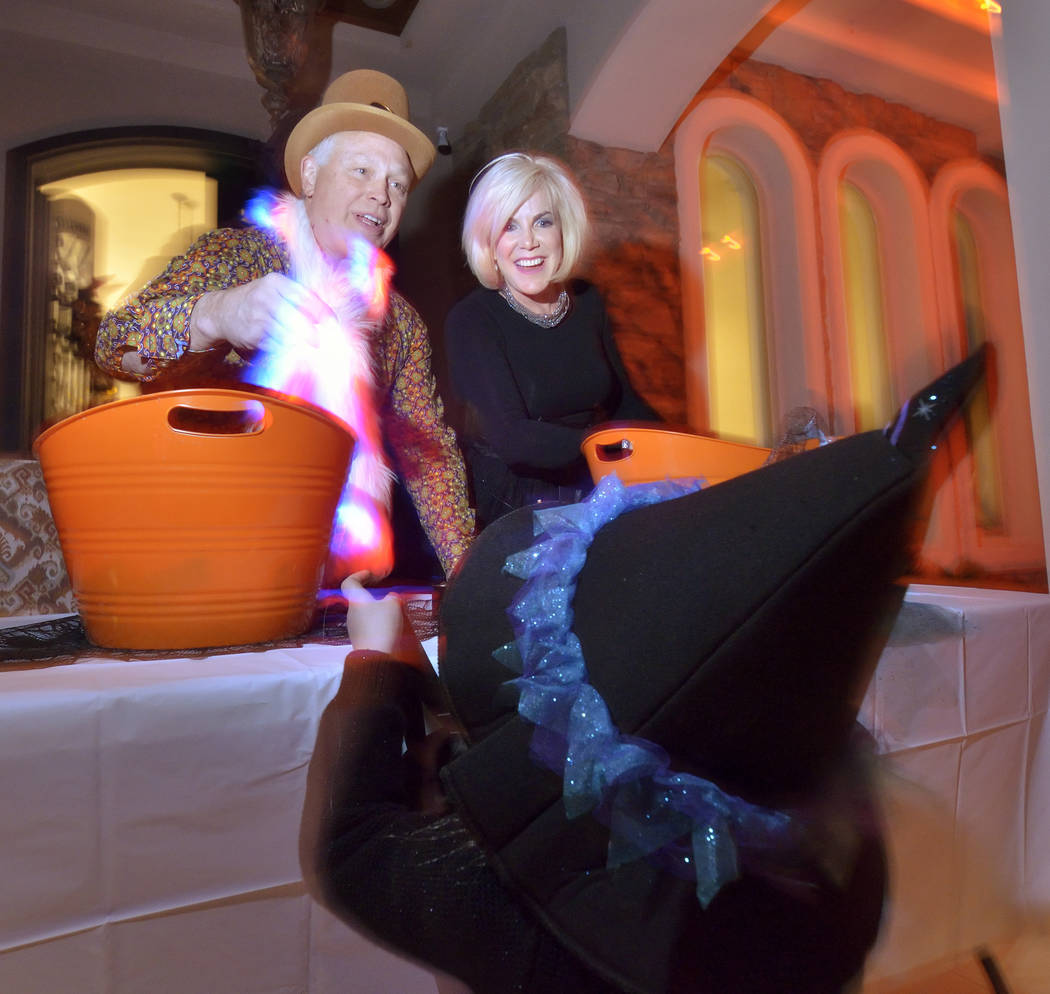 Bruce Burnett and his wife, Kris, dressed up for Halloween last year. (Bill Hughes Real Estate ...