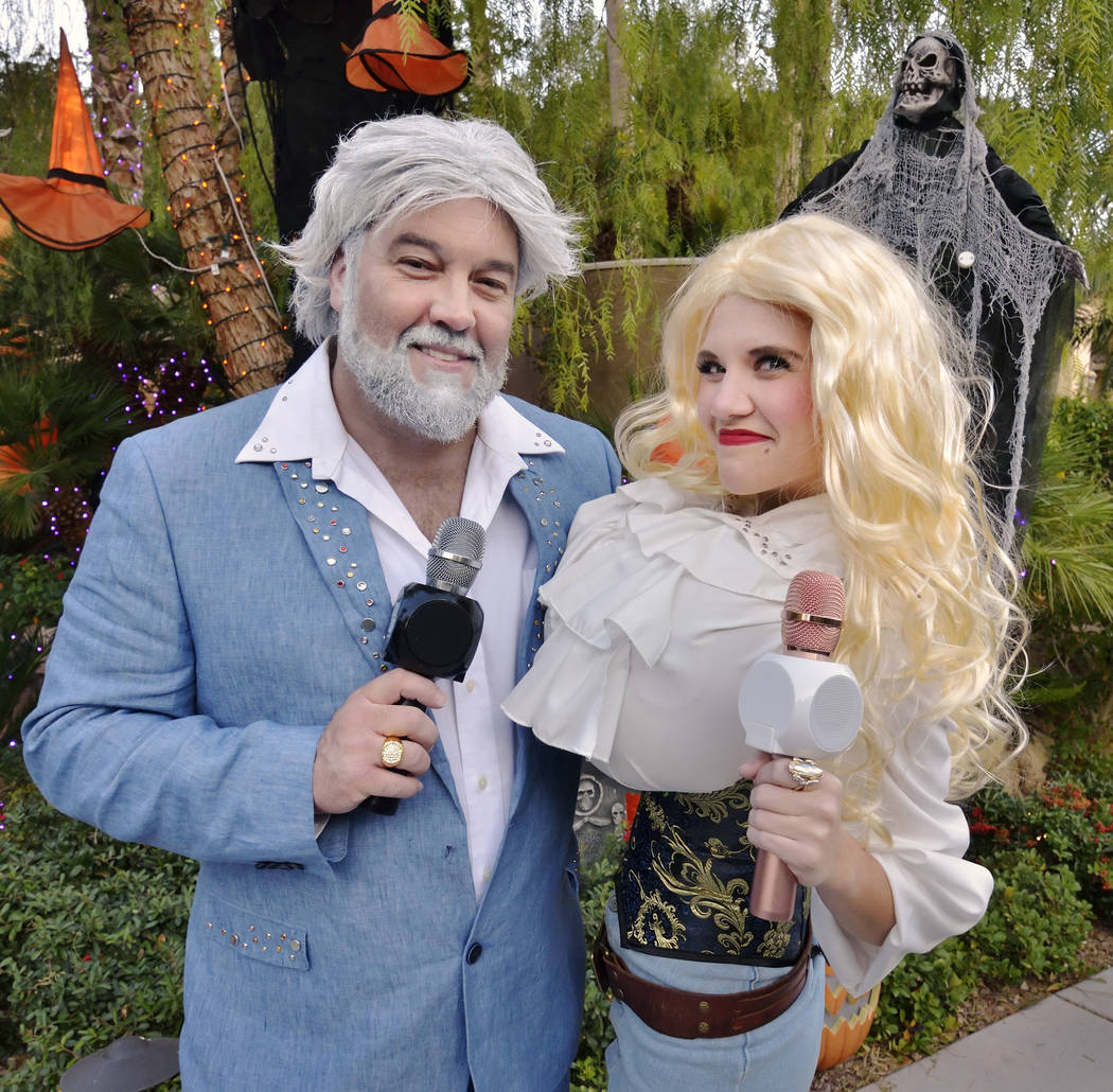 David Tolliver, as Kenny Rogers, and Jenna Pate, as Dolly Parton, are shown on Halloween night ...