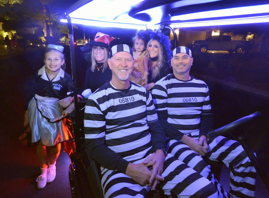 Out for a night of trick-or-treating are, from left, Presley and Wendy Walker, Robb Beville and ...
