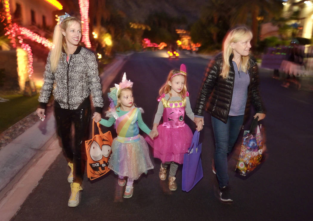 Brittany Godard, left, is shown with her daughters, Max and Catalina, and her mother, Nancy Web ...