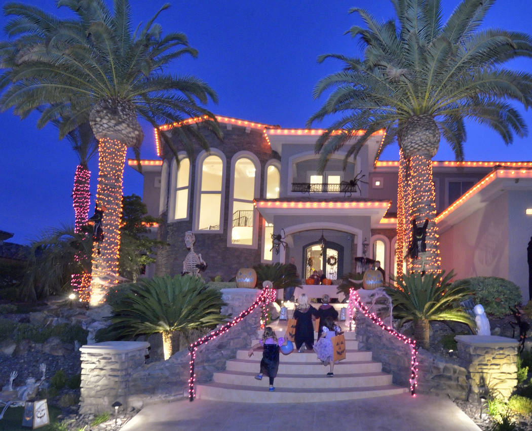 Trick-or-treaters climb the stairs to a Red Rock Country Club home. (Bill Hughes Real Estate Mi ...