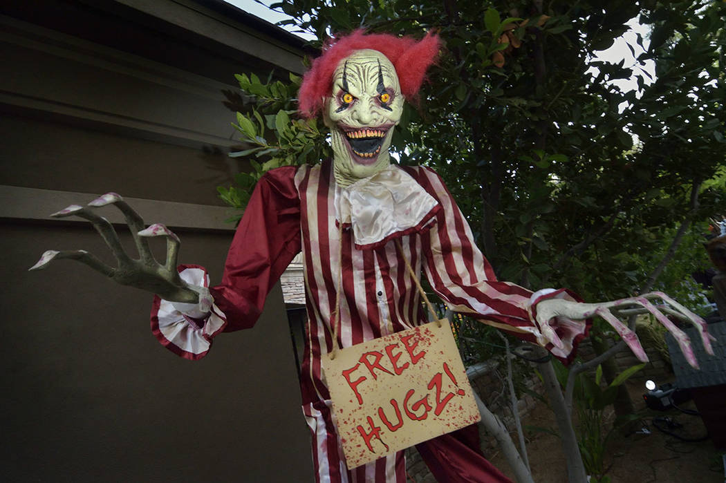 A scary clown is ready to greet Halloween guests. (Bill Hughes Real Estate Millions)