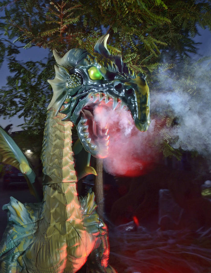 A fire-breathing dragon is part of Carmine Vento's Halloween display. (Bill Hughes Real Estate ...