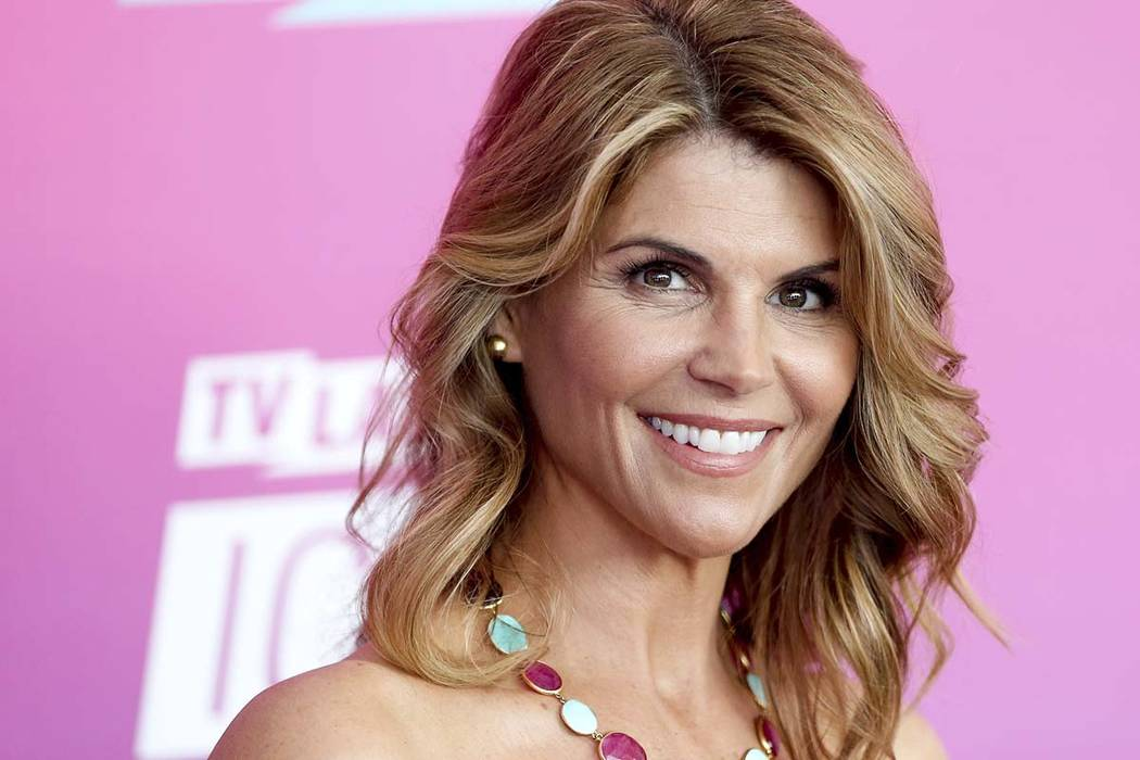 In this April 10, 2016 file photo, actress Lori Loughlin arrives at the TV Land Icon Awards in ...