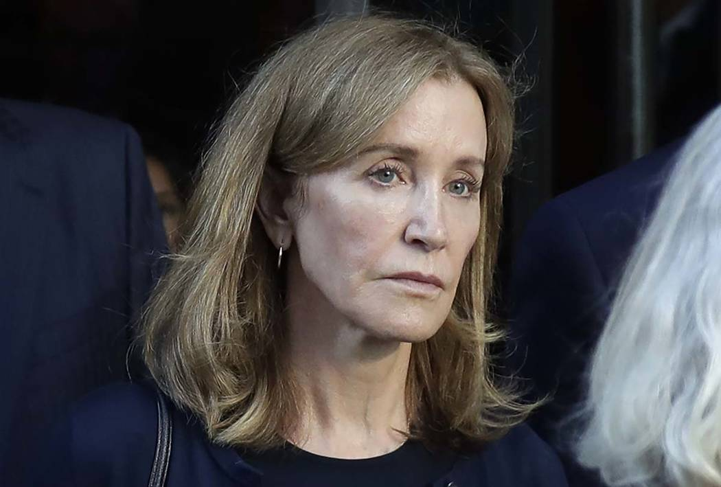 A Sept. 13, 2019, file photo shows actress Felicity Huffman leaving federal court after her sen ...