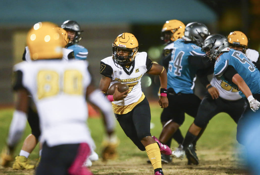 Clark quarterback My'quel Johnson (7) runs the ball during the first half of a football game at ...