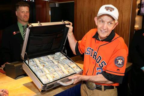 "Jim ""Mattress Mack"" McIngvale holds a suitcase full of cash before making a $3.5 million wa ..."