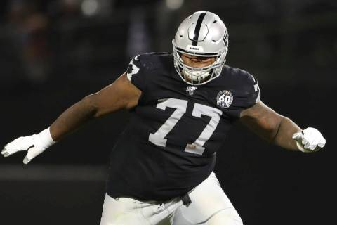 Oakland Raiders offensive tackle Trent Brown (77) protects a gap in the offensive line during a ...