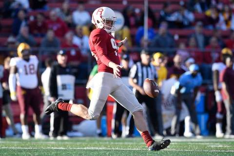 Rutgers punter Adam Korsak (94) kicks the ball during the first half of an NCAA college footbal ...