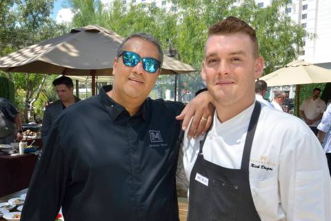 Chef Michael Mina, left, and Nick Dugan, executive chef at Michael Mina Bellagio, are shown dur ...