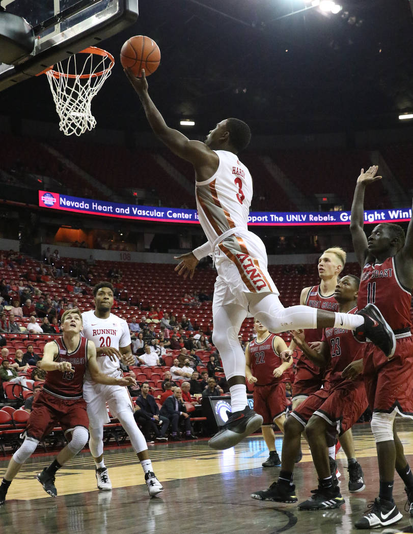 UNLV's guard Amauri Hardy (3) goes for the basket during the first half of their game against W ...
