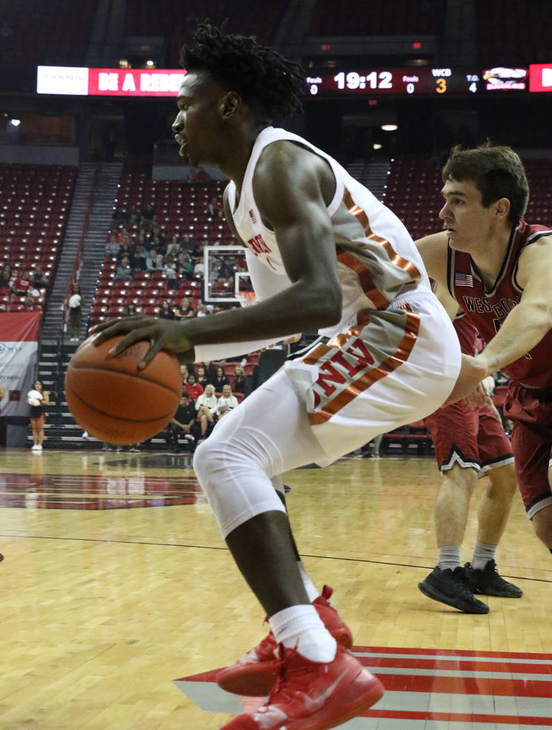 UNLV's forward Donnie Tillman drives past West Coast Baptist guard Andy Gilmer during the first ...