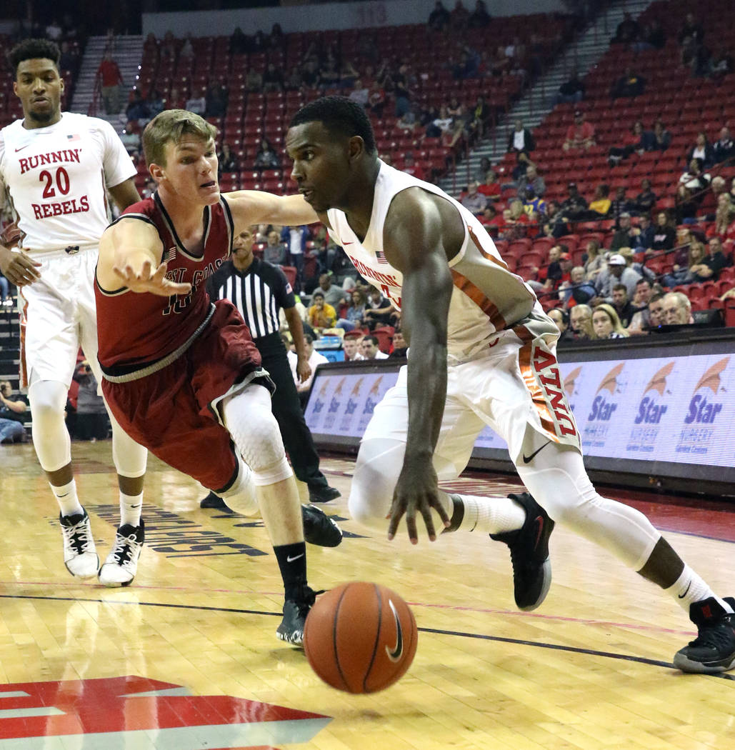 UNLV's guard Amauri Hardy drives past West Coast Baptist guard Andy Gilmer during the first hal ...