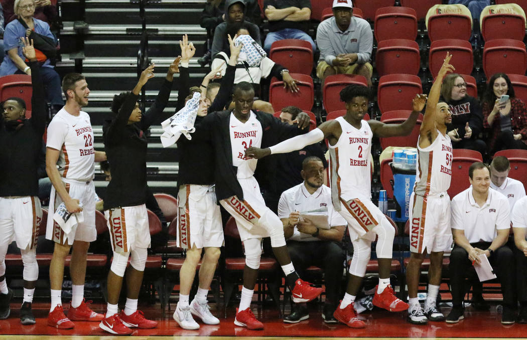 UNLV basketball players cheer for their teammates during the second half of their exhibition ga ...