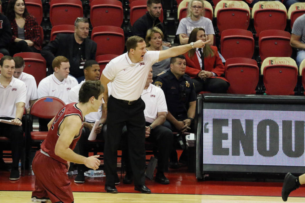 UNLV's basketball head coach T.J. Otzelberger directs his players during the second half of the ...