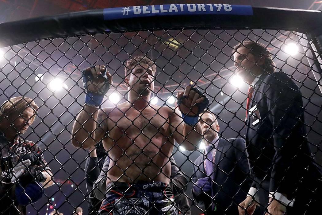 Frank Mir, center, reacts losing to Fedor Emelianenko, of Russia, in a heavyweight mixed martia ...