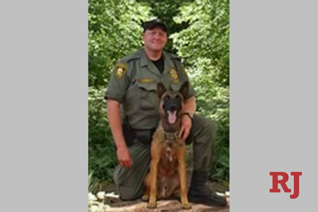 Metro patrol dog Hunter, seen with his handler Jeff Corbett, was stabbed in the neck by a suspe ...