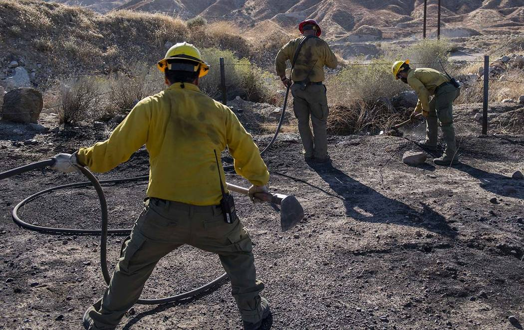 An engine crew looks for any remaining hot spots from the Tick Fire, Thursday, Oct. 25, 2019, i ...