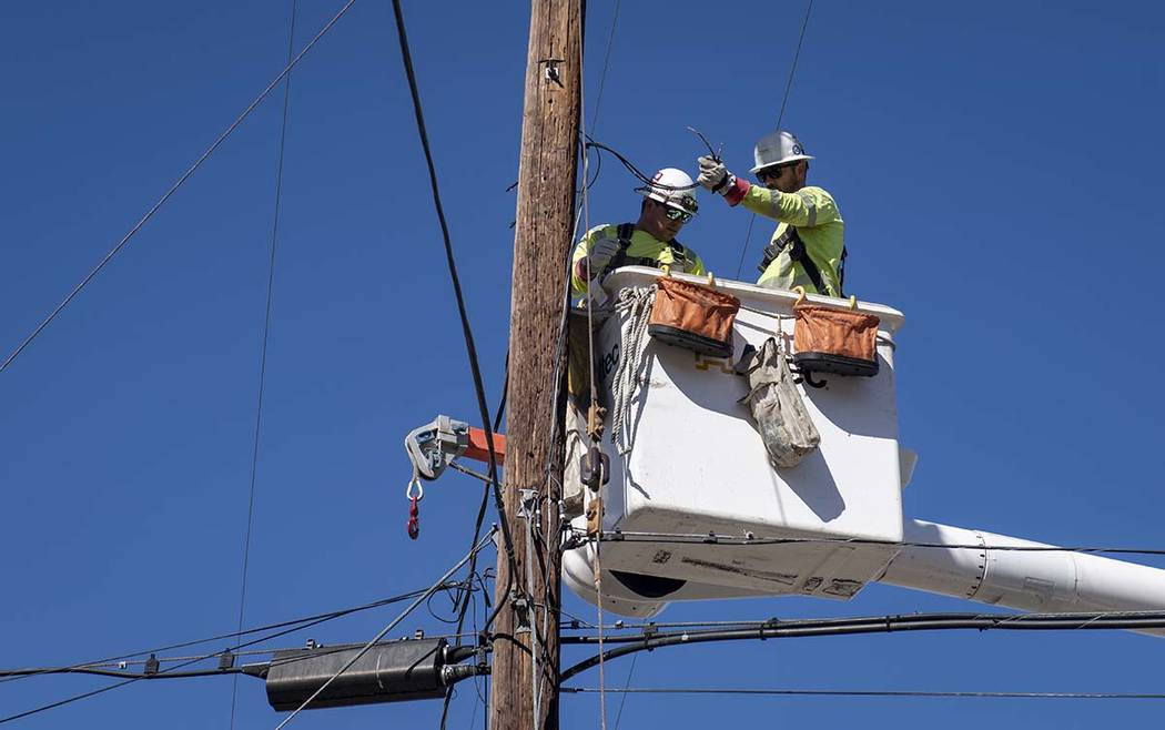 SoCal Edison crews replace power lines that were damaged from the Tick Fire, Thursday, Oct. 25, ...