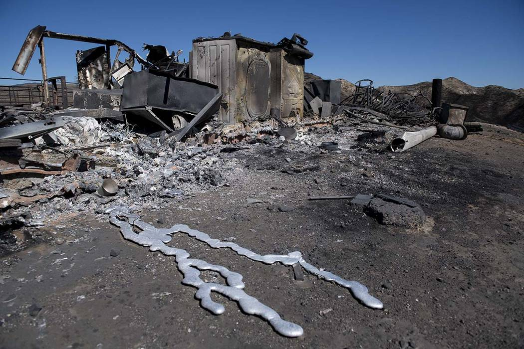 Debris from a hilltop home smolders after being burned by the Tick Fire, Thursday, Oct. 25, 201 ...