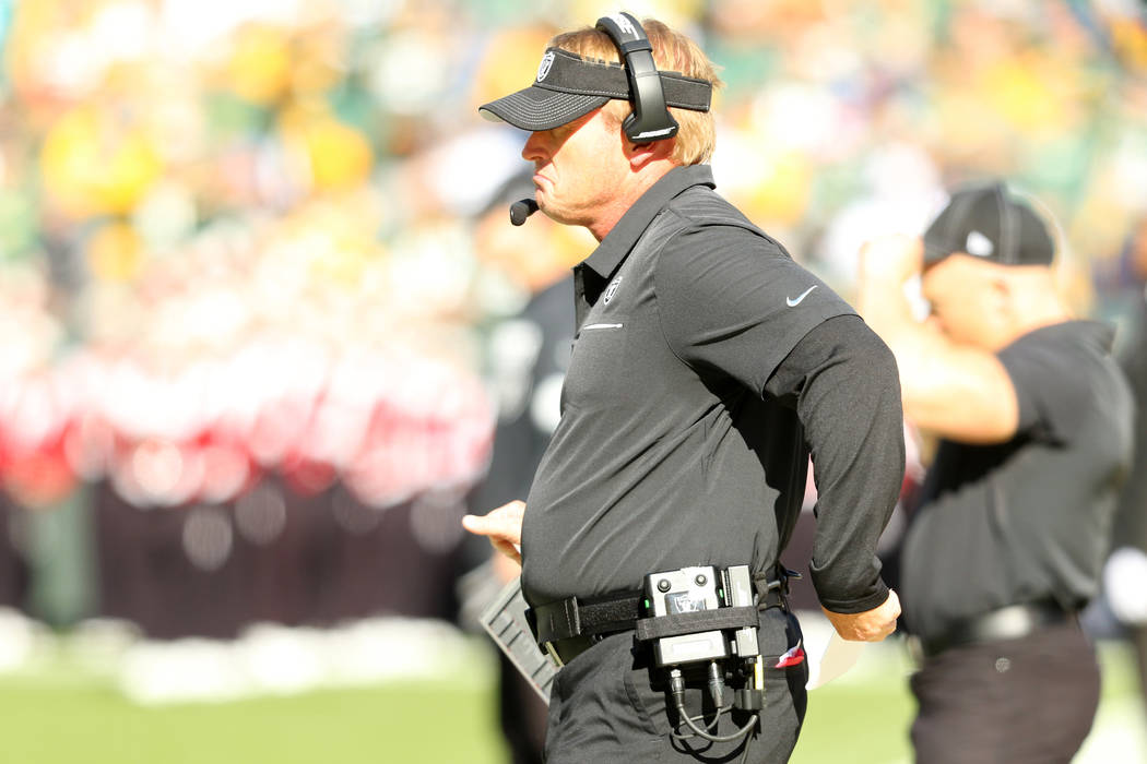 Oakland Raiders head coach Jon Gruden watches the game on the sideline during the first half of ...