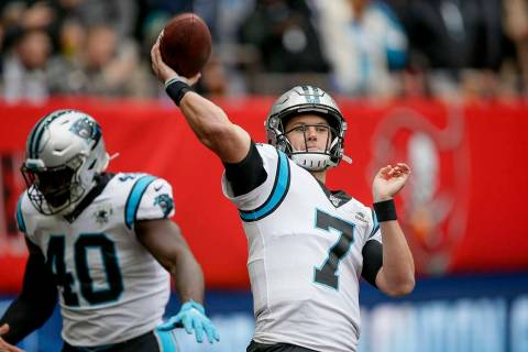 Carolina Panthers quarterback Kyle Allen (7) warms up before an NFL football game against the T ...