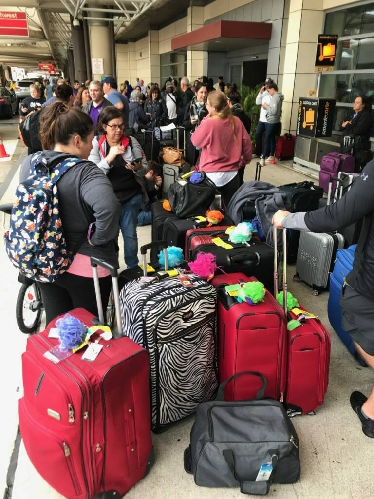 Crowds form at Louis Armstrong New Orleans International Airport after the remnants of Tropical ...