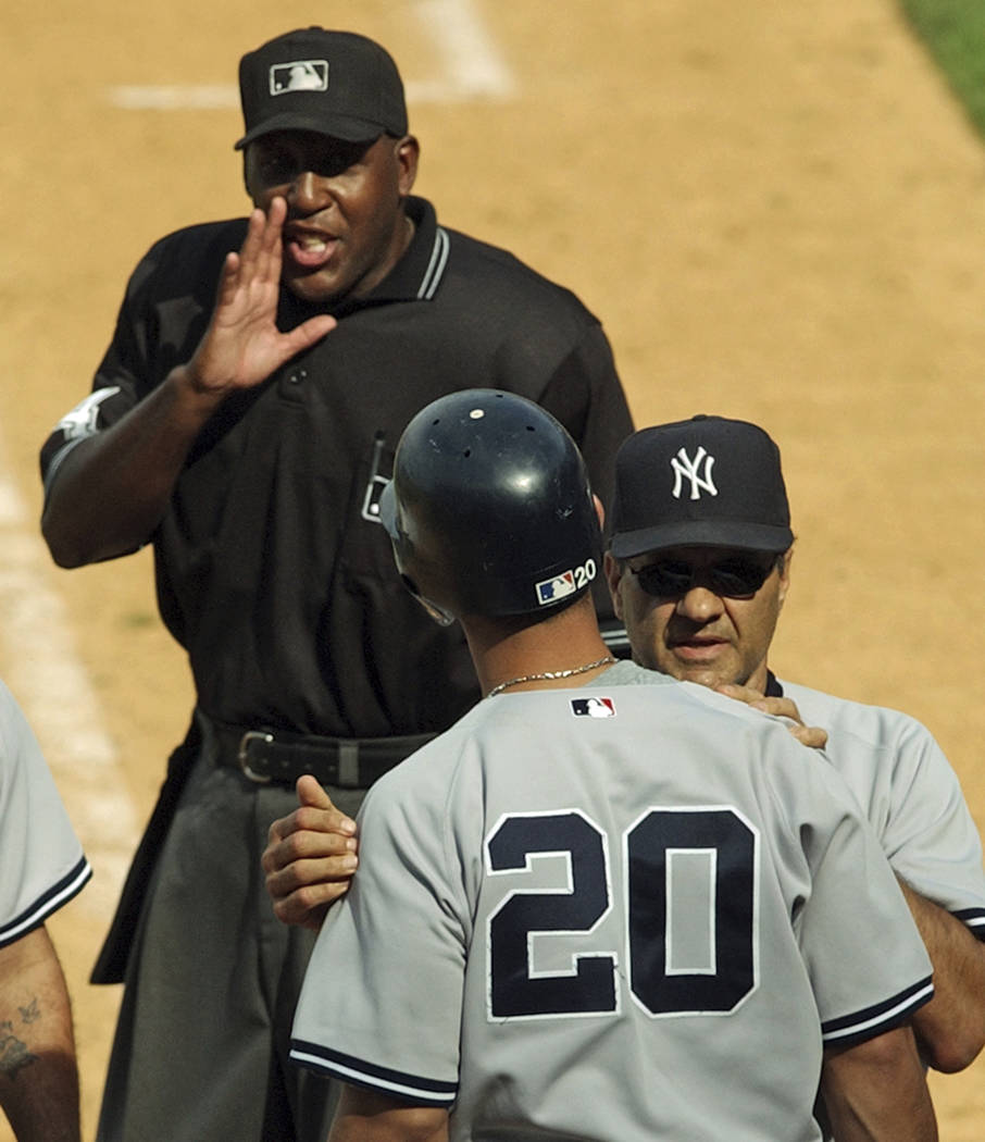 FILE - In this July 3, 2004, file photo, home plate umpire Chuck Meriwether, left, talks to New ...