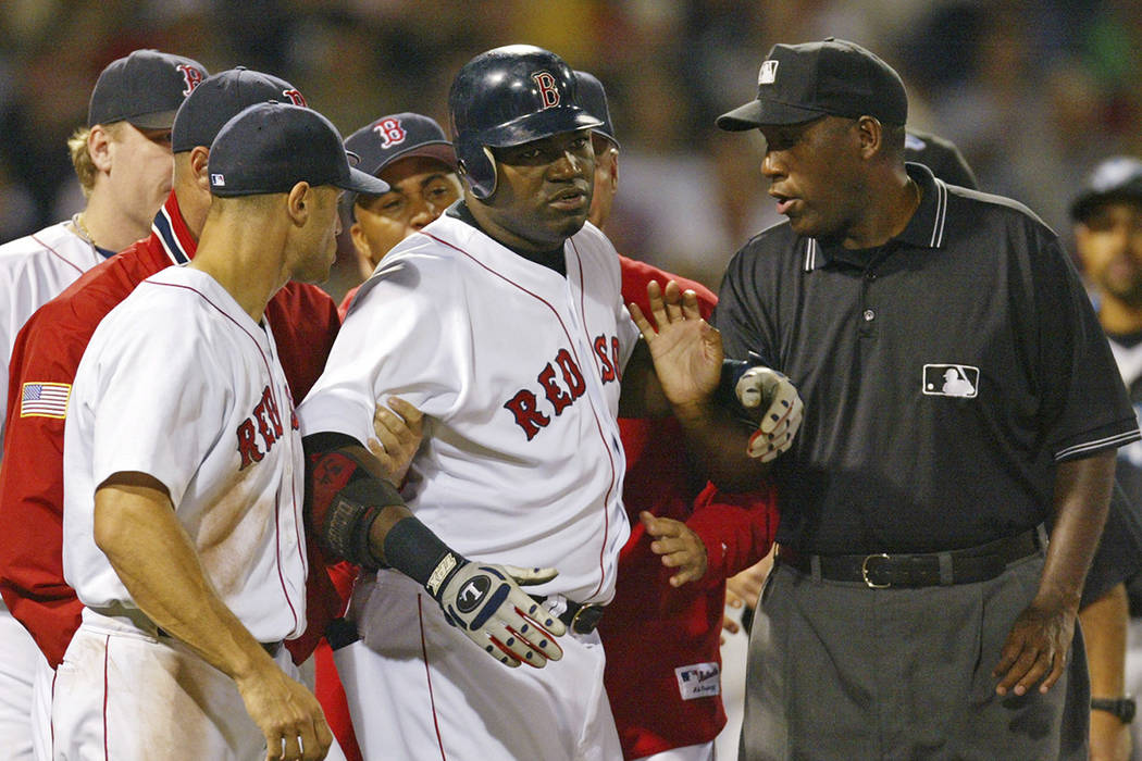 FILE - In this Aug. 17, 2004, file photo, Boston Red Sox David Ortiz, center, is restrained by ...