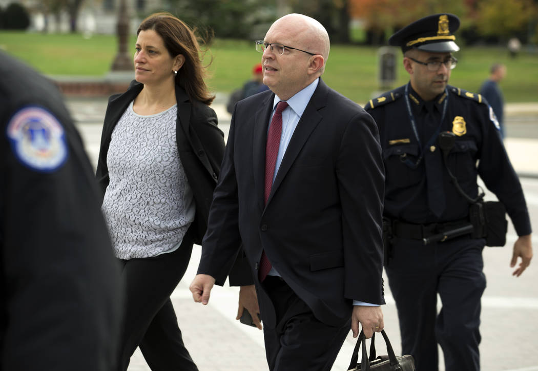 Philip Reeker, center, acting assistant secretary of state for Europe, arrives to the Capitol f ...