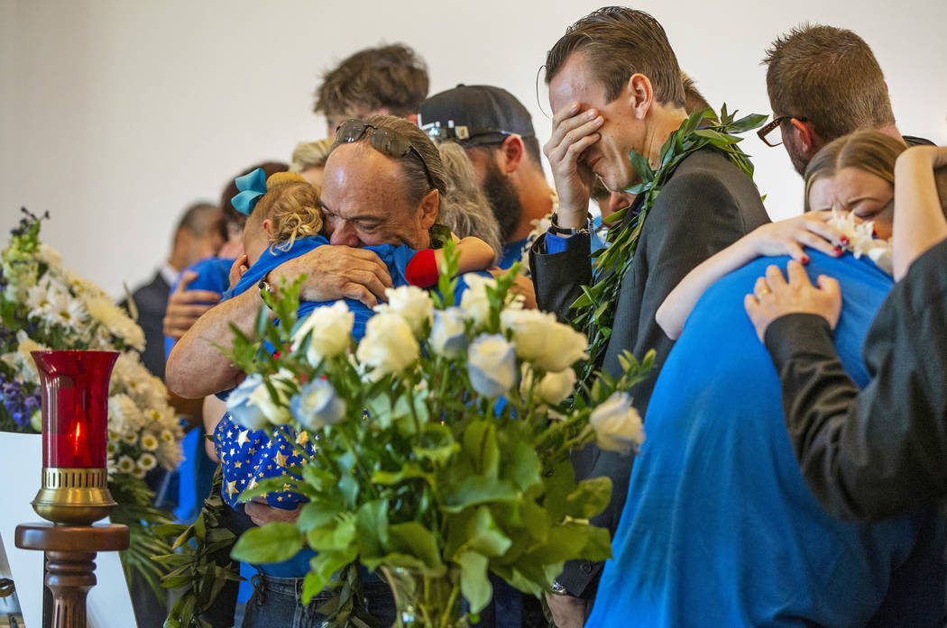 Sean Murray, center, weeps before the urn of his son Gavin Murray, 6, while surrounded by fami ...