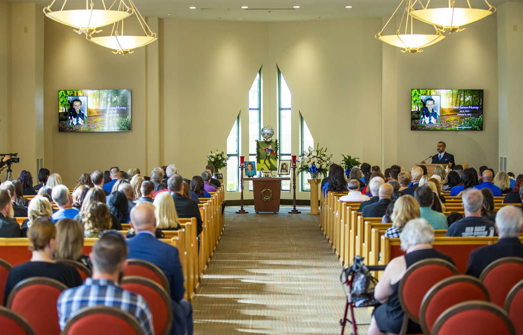 Rev. Jacob Jacoby gives a sermon during funeral services for Gavin Murray, 6, at Palm Mortuary ...