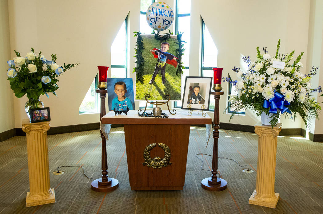 The urn and photos of Gavin Murray, 6, are presented before mourners during funeral services fo ...