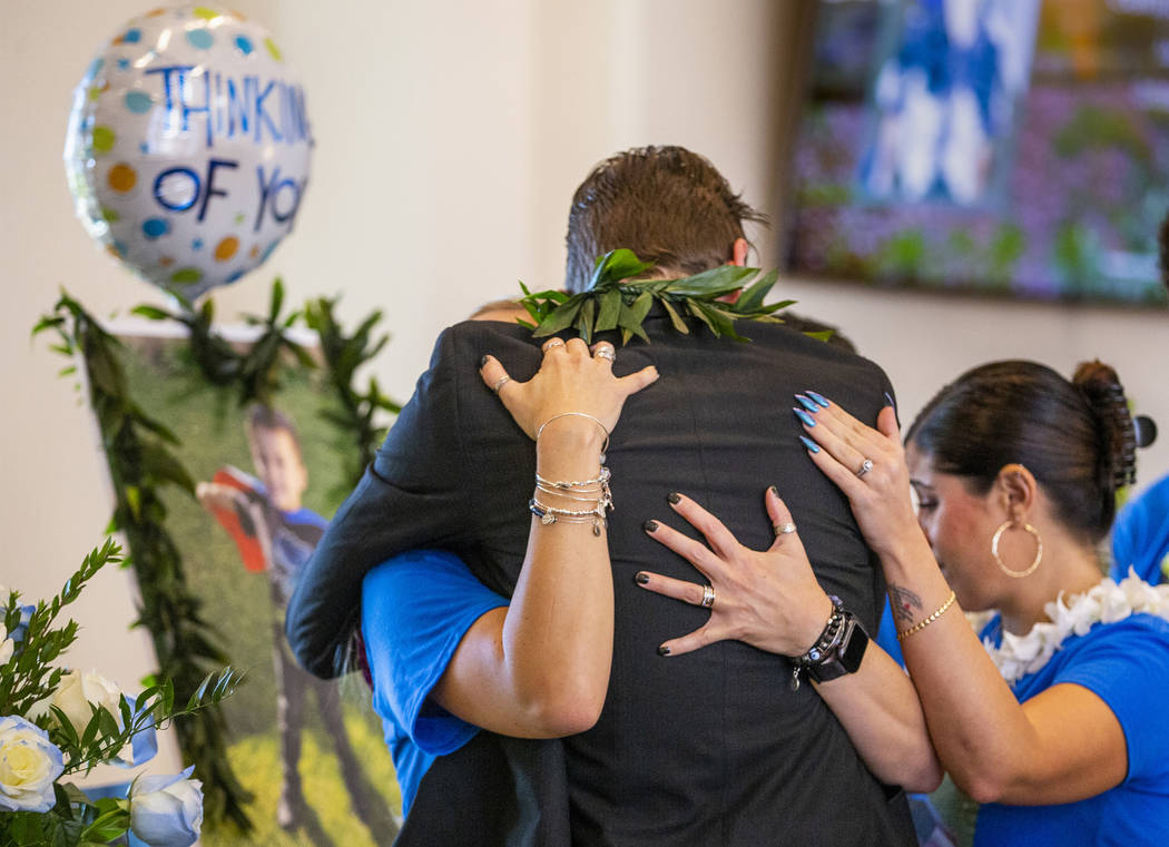 Sean Murray, center, is comforted by family members before the urn of his son, Gavin Murray, 6, ...
