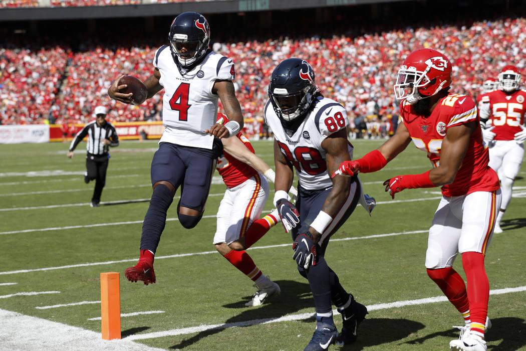 Houston Texans quarterback Deshaun Watson (4) scores a touchdown next to tight end Jordan Akins ...