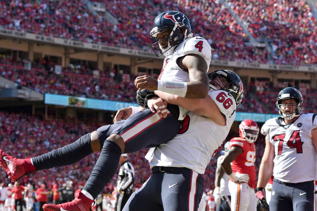 Houston Texans quarterback Deshaun Watson (4) celebrates his touchdown against the Kansas City ...