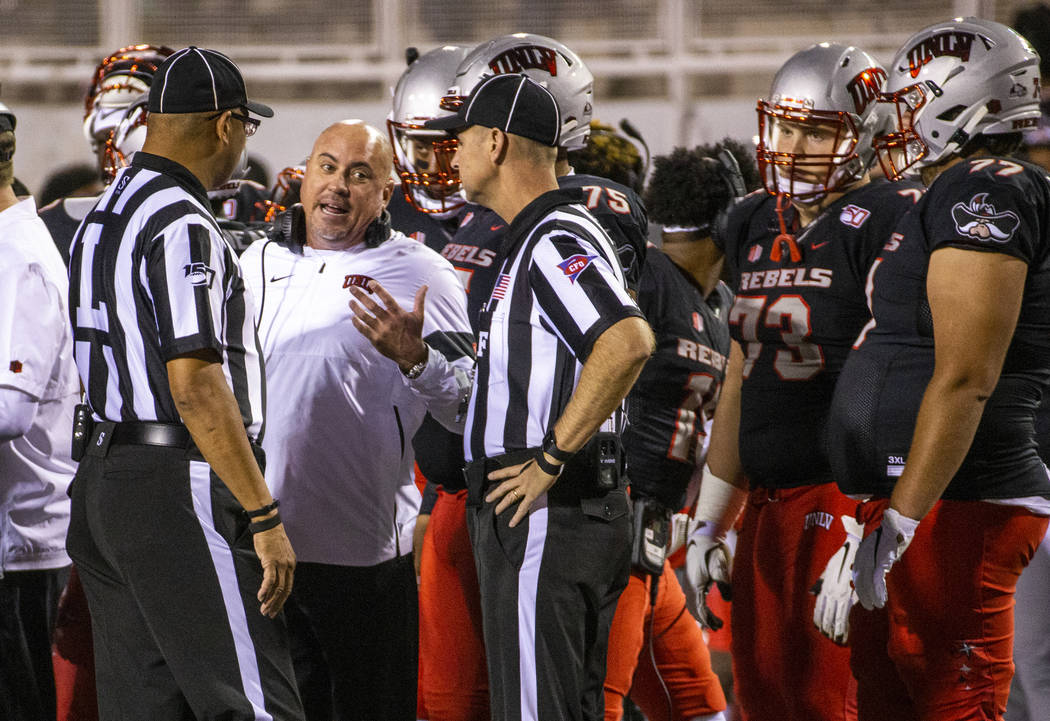 UNLV Rebels head coach Tony Sanchez pleads his case for a call against the San Diego State Azte ...