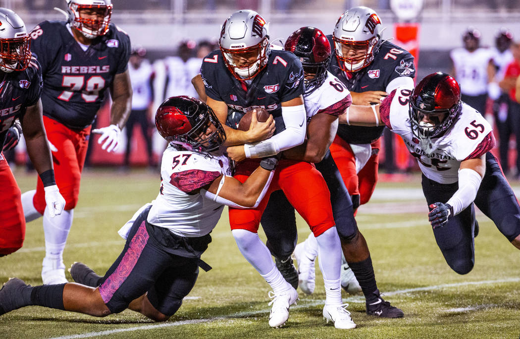 San Diego State Aztecs defensive lineman Keshawn Banks (57) and San Diego State Aztecs defensiv ...