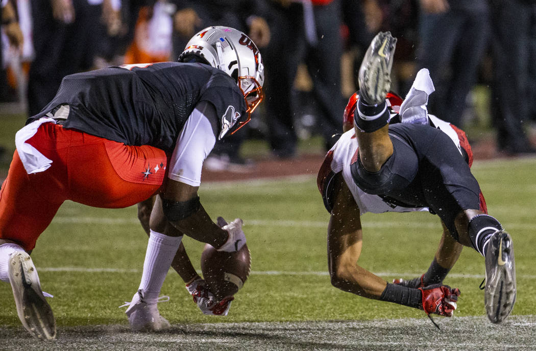 UNLV Rebels wide receiver Randal Grimes (4) makes a difficult catch as San Diego State Aztecs c ...