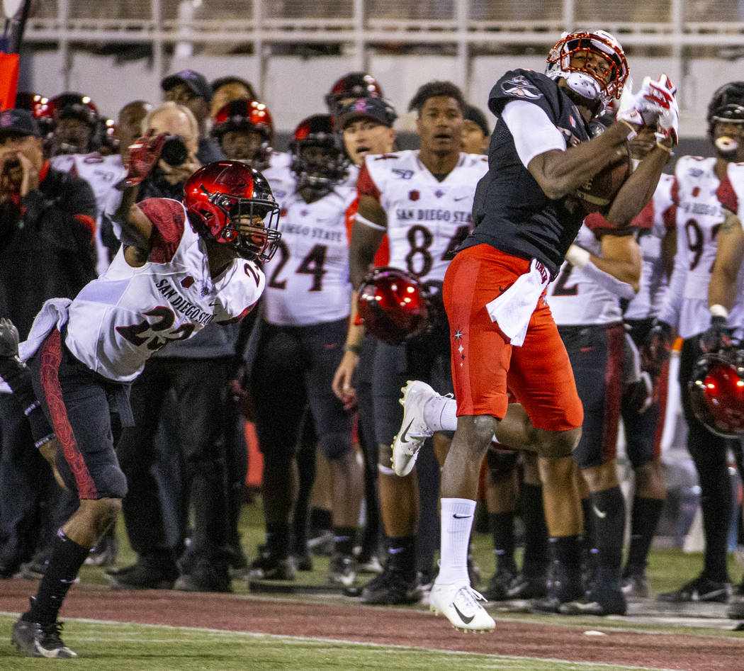 UNLV Rebels wide receiver Randal Grimes (4, right) secure a long pass reception over San Diego ...
