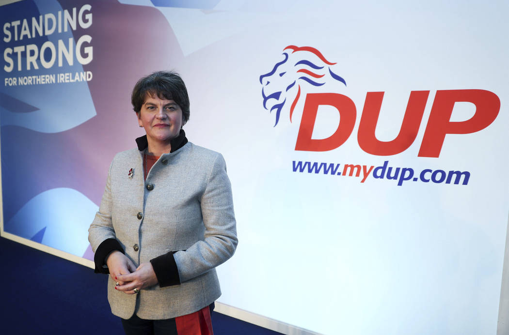 Democratic Unionist Party leader Arlene Foster poses on stage as she prepares for the the DUP a ...
