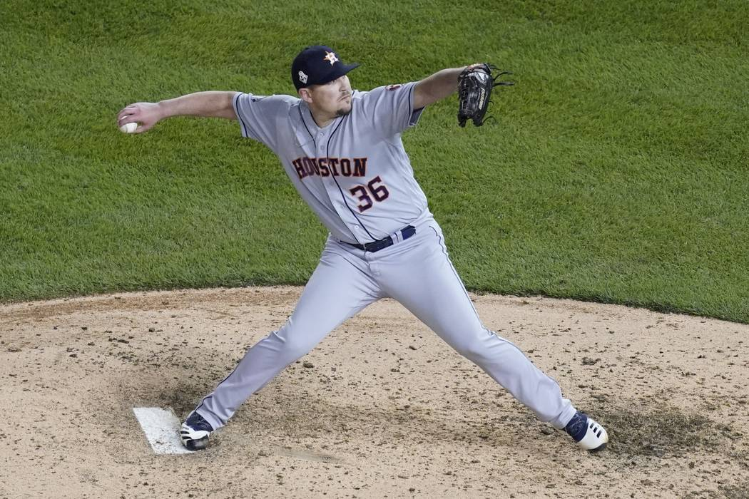 Houston Astros relief pitcher Will Harris throws during the sixth inning of Game 4 of the baseb ...