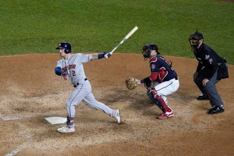 Houston Astros' Alex Bregman hits a grand slam during the seventh inning of Game 4 of the baseb ...