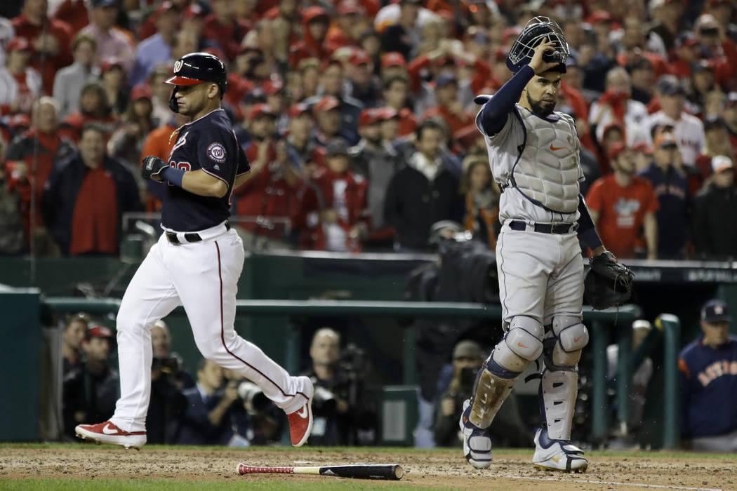 Washington Nationals' Gerardo Parra scores past Houston Astros catcher Robinson Chirinos during ...