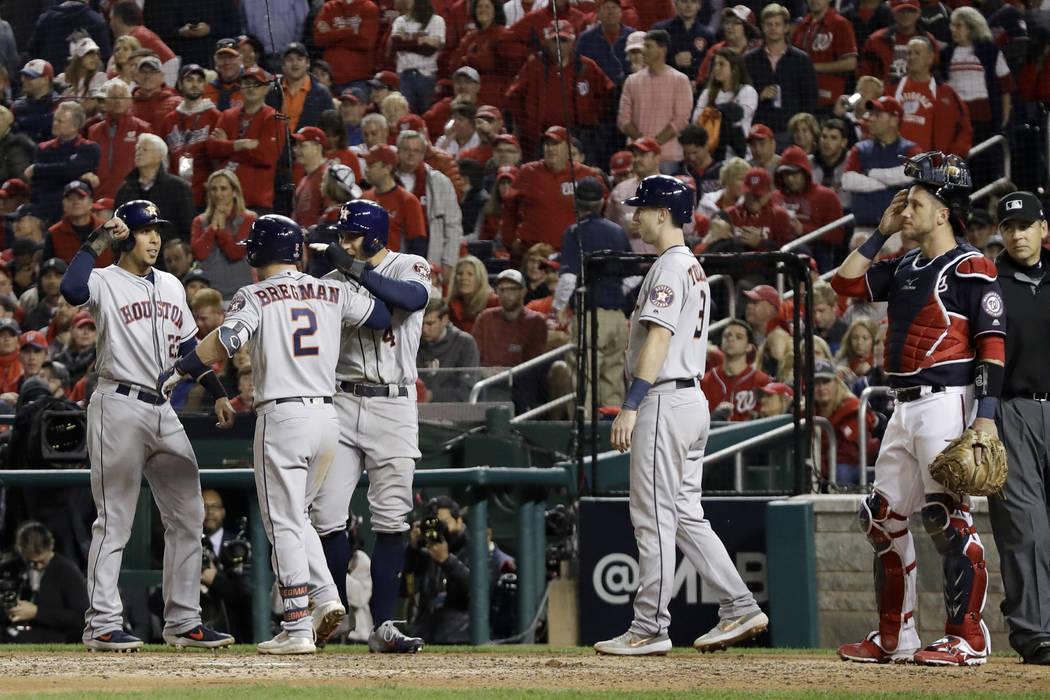Houston Astros' Alex Bregman (2) celebrates after his grand slam against the Washington Nationa ...
