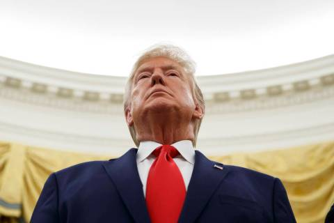 President Donald Trump stands during a Presidential Medal of Freedom ceremony for auto racing g ...