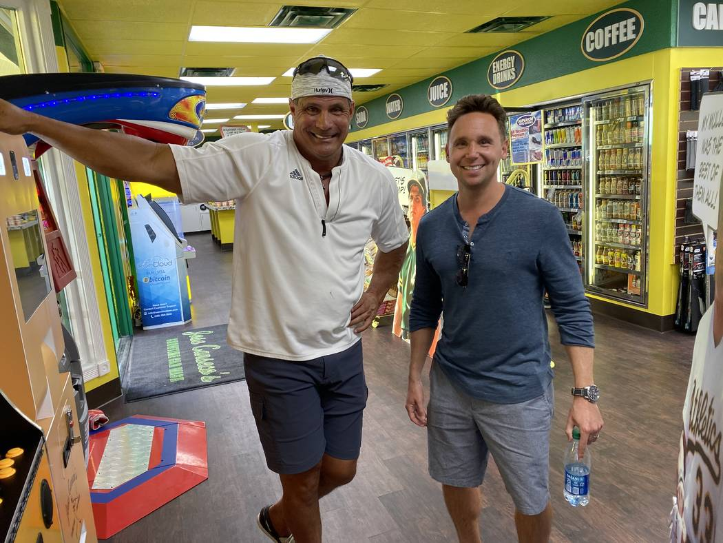 Jose Canseco is shown with comedian and podcast partner Martin Montana at the opening of Jose C ...