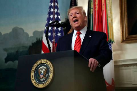 President Donald Trump speaks in the Diplomatic Room of the White House in Washington, Sunday, ...